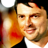jlh: Bones smiles in a suit (Bones smiles)