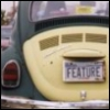 beckyzoole: VW Bug with license plate proclaiming that it's a Feature (buggy)