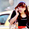 skygiants: Betty from Ugly Betty on her cell phone in front of a cab (betty on the go)