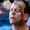 out_of_time: Jack with blood on his face and a gun to his head (Bad day)