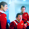 bristrek: Movie era of Spock, Kirk and McCoy next to each other on the bridge, Kirk in his chair (ST TOS core trio)