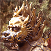 qilin: A brass qilin statue with a mane of fire. (mane)