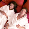 jlh: Neal and Diana on a bed in robes (white collar: Neal and Diana)