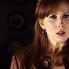 bristrek: upper body/head shot of Donna looking worried, dark but warm/brown colours (DW Donna worried)