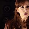 bristrek: upper body/head shot of Donna looking worried, dark but warm/brown colours (DW Donna worried)