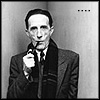 "klgaffney: The artist Duchamp standing in a corner holding a pipe in his mouth. He does not look impressed. (duchamp sez ""....."")"