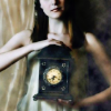 nightbird: Stock photo, woman holding old clock (and it's time that you love)