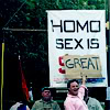 "simonejester: sign says ""homo sex is sin,"" word ""great"" covers ""sin"" ([queer] homo sex is great)"