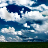 watersword: A blue sky full of puffy white clouds (Stock: sky)