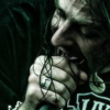 twisted_satyr: Photo of Lamb of God's frontman, Randy Blythe, screaming into a microphone like the metal god he is. (Kamelot black halo)