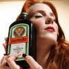 twisted_satyr: simone simons holding a bottle of jagermeister lovingly (booze, let's get fucked up)