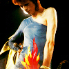 rusty_halo: bowie: ziggy onstage flames (bowie: ziggy onstage flames)