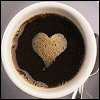 elaineofshalott: A cup of black coffee, its crema making a heart shape on its surface (coffee heart)