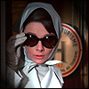 skygiants: Audrey Hepburn peering around a corner disguised in giant sunglasses, from Charade (sneaky like hepburnninja)