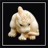 qilin: A crouching qilin figurine. (crouching)