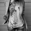 meroure: b&w, torso view of girl in skeleton shirt (your bones supersede loveliness)