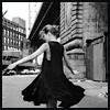 bellchronicles: a woman in a black dress twirls about (black twirl)