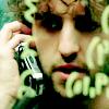 paraka: Charlie on the phone looking at equations looking worried (N3-C-Worried)