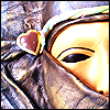 wallwalker: Venetian mask with mouth covered, largely made of a shiny purple material. (purple ninja)