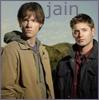 "jain: Sam and Dean Winchester standing shoulder-to-shoulder. Text: ""jain"" (supernatural)"