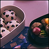 jain: Bento box containing rice balls decorated with seaweed hearts. (love bentou)