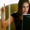 "jain: Rachel Zane at her computer gesturing ""Hold on a minute!"" (suits rachel just a minute!)"