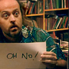"misbegotten: Black Books' Manny holds a sign saying ""oh no"" (BB Manny Oh No)"