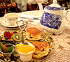 liv: Table laid with teapot, scones and accoutrements (yum)