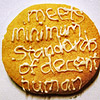 "kate_nepveu: cookie with ""meets minimum standards of decent human"" written in icing (have a cookie)"