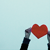 sideways: [o] heart being brandished in air (►she keeps my heart)