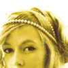 murklins: photo of greta salpeter, sunlit and golden. cropped just above lips to highlight an arched brow and her pearl headband. (so lovely)