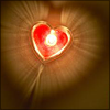 revolutions: A heart-shaped candle seen from above. (heart candle)