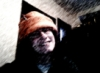 lyonesse: me in my winter hat in the craft room (hi-viz)