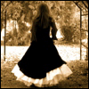 besina_sartor: back view of a girl in an old-fashioned dress walking thru an archway outdoors. Sepia tone. (red panda)