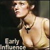 copracat: Leela leaning forward showing significant cleavage and the text 'Early influence' (leela)