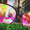 rainfall: Light refracts through glasses on the grass. (rose colored glasses)