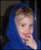 pne: A picture of a toddler with a mischievous grin on her face, wearing a blue bathrobe. (Amy 2007)