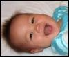 kate_nepveu: infant grinning fiercely (SteelyKid - fierce huge grin (2009-05))