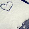 revolutions: A heart shape drawn in snow. (heart in the snow)
