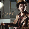 "apollymi: Hatter with a cuppa, text reads ""Tea?"" (Alice**Hatter: Tea?)"