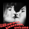 pensnest: Two Kit Kat girls about to kiss, caption Wilkommen, Bienvenue, Welcome (Cabaret)