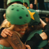 theleaveswant: three women in roller derby gear (Hurl Scouts from Whip It) hug and laugh (group hug)