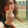 theleaveswant: white woman (Ellen Page as Bliss Cavender) shows her middle finger to the camera (the bird)