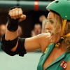 theleaveswant: a white woman (Zoe Bell as Bloody Holly) in roller derby uniform and safety gear holds up a hand for fistbumps (fistbump of joy)