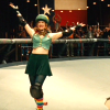 theleaveswant: A white woman (Drew Barrymore as Smashley Simpson) in roller derby uniform makes victory arms in front of Texas flag (ta-da!)