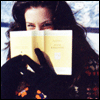 mayhap: Liv Tyler with a book pressed to her face (Liv Tyler)