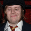mayhap: Patrick Stump with a tie in Gryffindor colors and a smug smile (Gryffindor smug)