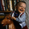 ext_45525: Gleeful Baby Riding A Bouncy Horse Toy (Shanks Giggles)