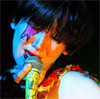 ardhra: Karen O of The Yeah Yeah Yeahs with stage make-up, singing into a microphone (Karen O)