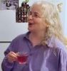 redbird: closeup of me drinking tea, in a friend's kitchen (farthing party 2007)